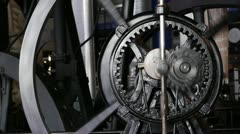 Old steam engine gear system which uses planetary gears. - stock footage