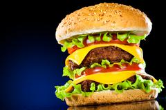 tasty and appetizing hamburger on a dark blue - stock photo