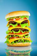 tasty and appetizing hamburger on a blue - stock photo