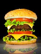 tasty and appetizing hamburger on a dark - stock photo