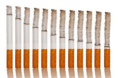 Lighted cigarettes Stock Photos