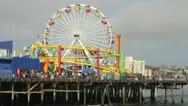 Santa Monica Pier amusement rides and ferris wheel Stock Footage