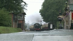 Low Shot of a Steam Train Entering Platform on a Rainy Day.HD Stock Footage