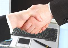 hand shake of two people. - stock photo