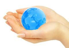 hand of the person holds globe - stock illustration
