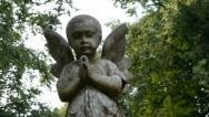 Stock Video Footage of Memorial cherub - Camera move.
