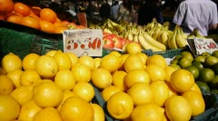 Stock Video Footage of Lemons for sale in a busy market.