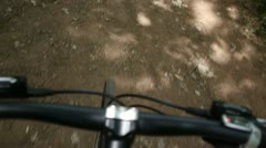 A bike riding along a dirt track. Shot from the bike. Stock Footage