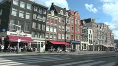 Netherlands Amsterdam awnings cafe and gabled houses - stock footage
