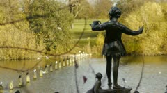 The bronze of Peter Pan in Kensington Gardens. Stock Footage
