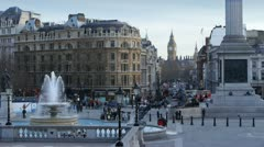 Busy scene in Trafalgar Square, London. Big Ben in the background. Stock Footage