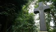 Christian cross. Trees background. Camera move then hold. Stock Footage