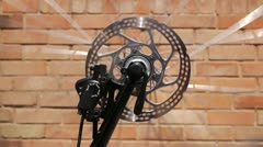 Spinning bicycle wheel. - stock footage