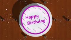 Birthday cake with candles on a table surrounded by party poppers. Stock Footage