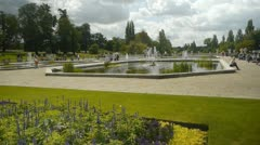 Fountains and ponds in the Italian Garden in Kensington Gardens on a sunny day. Stock Footage