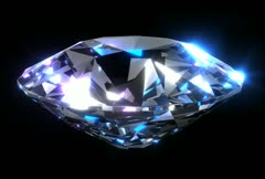 Large diamond revolving and catching the light with colorful sparkles. Loops. Stock Footage