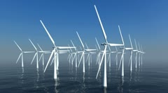 An array of wind turbines out at sea. Loops. Stock Footage