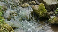 Part of a stream flowing over some rocks. Stock Footage