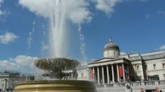 One of the fountains in Trafalgar Square in London. Stock Footage