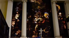 Stained glass window and eucharist candle. Stock Footage