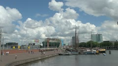 Netherlands Amsterdam walkway to nemo and tall masts Stock Footage