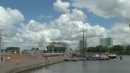 Stock Video Footage of Netherlands Amsterdam walkway to nemo and tall masts