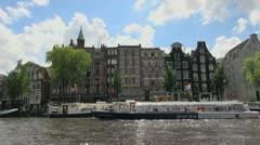 Netherlands Amsterdam black and white canal boat moving Stock Footage