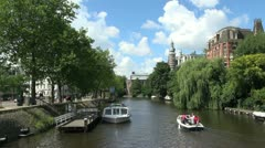 Netherlands Amsterdam tour boat and small craft Stock Footage