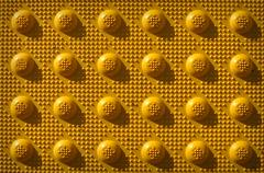 Yellow repeat knob pattern Stock Photos