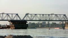 Barge under the railway bridge Stock Footage