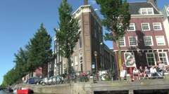 Netherlands Amsterdam upward at building rounding bend in canal Stock Footage