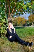 woman under mountain ash tree - stock photo
