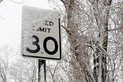 Road sing under snow Stock Photos