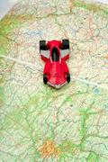traveling by car on world map - stock photo