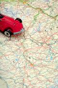 Traveling by car on world map Stock Photos