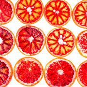 rows of sliced blood orange - stock photo