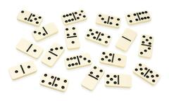 chaotic arranged dominoes on white - stock photo