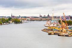 view on tivoli grona lund and beckholmen island stockholm - stock photo