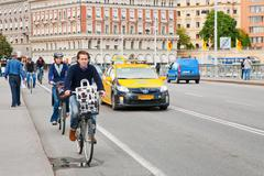 Bicyclists on street in stockholm, sweden Stock Photos