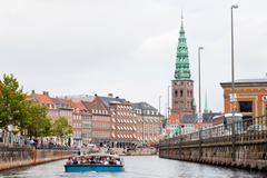 Boat guided tour on frederiksholms kanal, in copenhagen Stock Photos