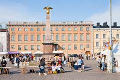 Stock Photo of market square and  stern obelisk of empress alexandra in helsinki