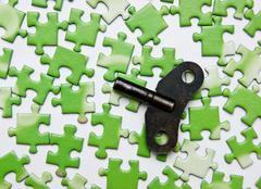 Stock Photo of key on the green puzzle