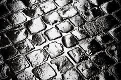 Wet cobbled roadway Stock Photos