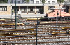 Railway tracks and depot with train - stock photo