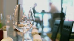 Waiter comes to clients behind waterwall in eastern restaurant Stock Footage