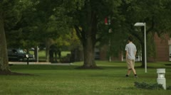 Student Walking Through College Campus WS Stock Footage