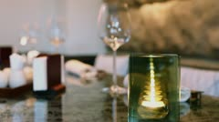 Reflections in candleholder which stands on table Stock Footage