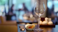 Clients sit in restaurant, focus on glass with napkin at table Stock Footage