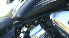 Tilt Down CU of Motorcycle Engine and Gas Tank Stock Footage