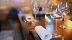 Candle burns at table near watewall in restaurant Stock Footage
